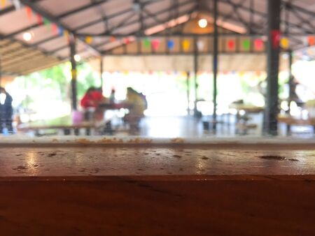 Empty wooden table with blurred restaurant