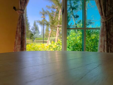 Empty table with blurred background with window and garden Stock fotó