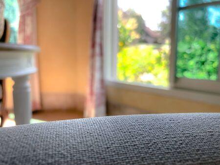 Empty sofa with blurred background with window and garden Stock fotó