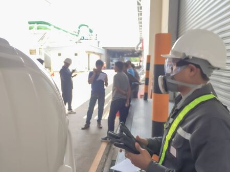 Blurred of Safety engineer with gas mask at work place