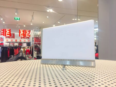 Empty white sign standing at shopping mall with sale time.