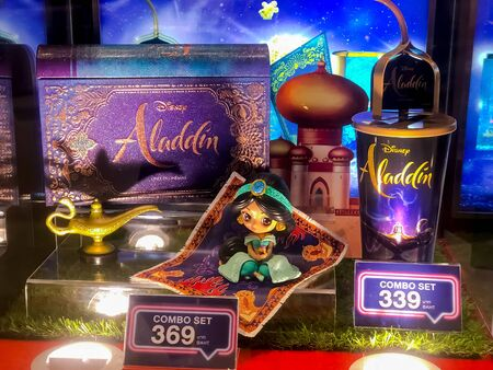 Nakhon Ratchasima/Thailand - June 23 2019:foil cinema cup with spinning straw and the book popcorn container with princess jasmine on magic carpet set aladdin disney the movie  on shelf at the cinema