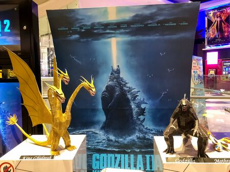 Nakhon Ratchasima/Thailand - Jun 23 2019:Godzilla and ghidorah the three headed monster the movie on shelf at the cinema. Sajtókép