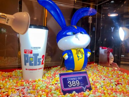 Nakhon Ratchasima/Thailand - Jun 23 2019:soft drink cup and Snowball Popcorn bucket set The Secret Life of Pets 2 the movie on shelf at the cinema.