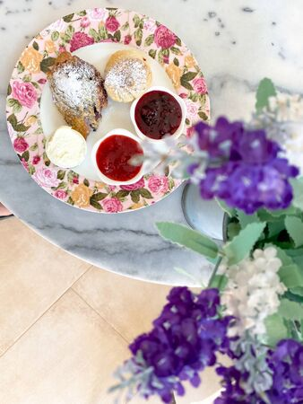 scones with jam and cream,tea break time with dessert on marble table