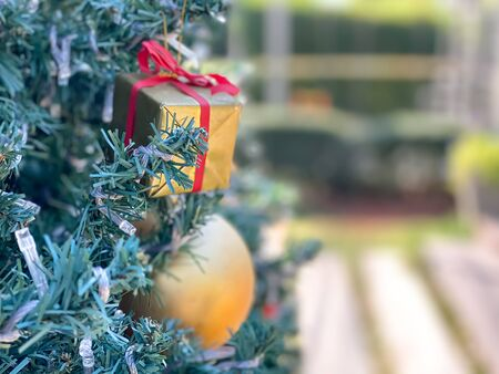 Christmas background,gift,ball and bell in pine tree with blurred background Stok Fotoğraf