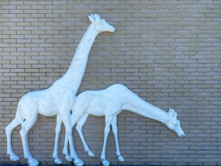 Background of old vintage brick with statue of giraffe wall textures