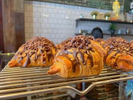 Croissant With Chocolate Chip Topping at cafe with blurred background Stock fotó