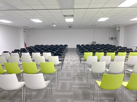 Empty clean room with chairs and tables for training,meeting