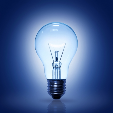 blue light: light bulb on blue background.