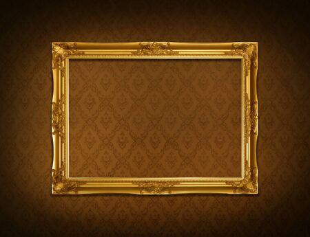 Gold frame stuck on the wall wallpaper thai the dark