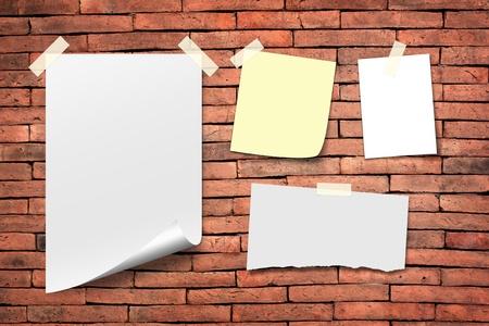 white paper notes. Stick tape on the orange brick wall photo