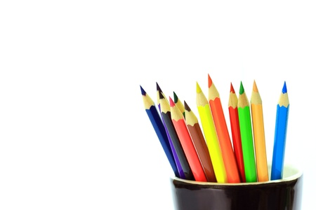Various colored pencils in black cup on white background.  Stock Photo - 9868088