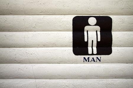 Men bathroom sign. The black paint on concrete walls.  photo