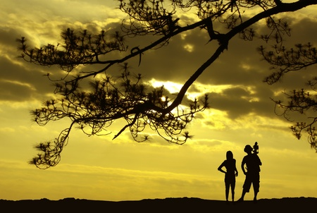 Silhouette of photographer and woman. in the atmosphere. Sunrise photo