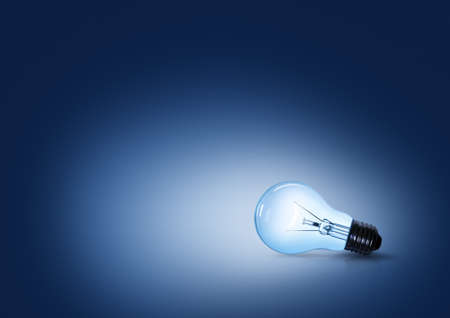 light bulb on blue background on the ground side.  photo