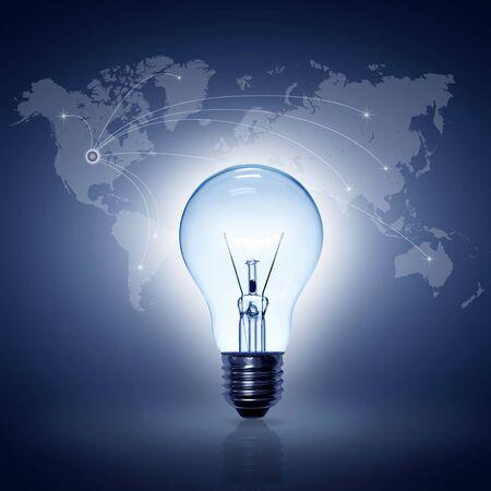 light bulb on blue background world map online international photo