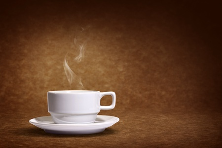 brown cup tea: coffee cup on brown background  Stock Photo