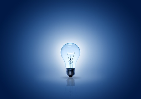 glowing light: light bulb on blue background