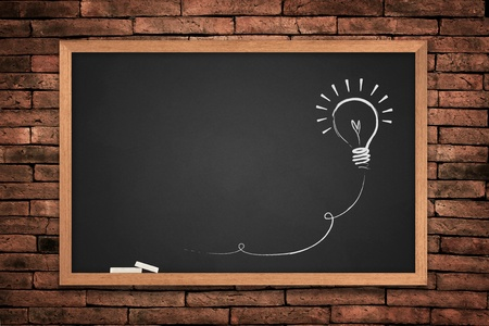 teacher: Drawing of a bulb idea blackboard on wall background  Stock Photo