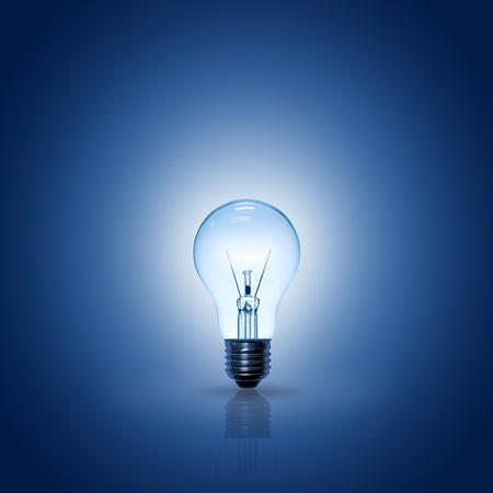 light bulb on blue background.  Stock Photo - 10017067