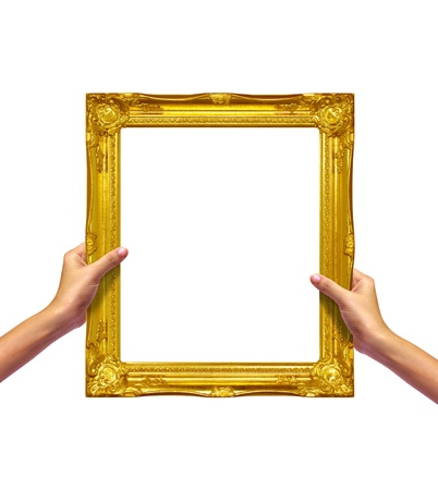 gold frame in hand on white background Stock Photo - 10314657