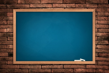 Blue board on old wall background  photo