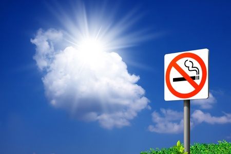 signs No smoking. on the sky background.  photo