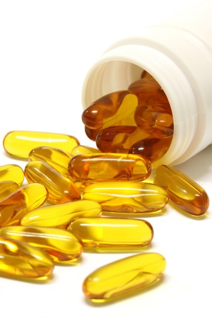 cod oil: gold cod liver fish oil capsule, on Bottle on white background.