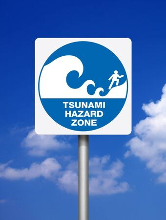 tsunami: Tsunami warning blue signs on blue sky background