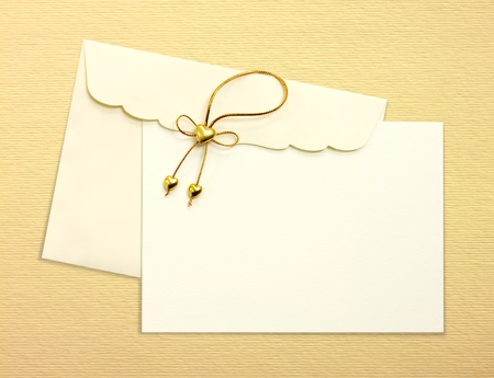yellow heart: Envelope and mail wedding invitations, golden heart, on yellow background