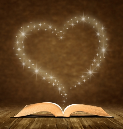 bible backgrounds: open old book. a star, heart graphic at the top of the book.