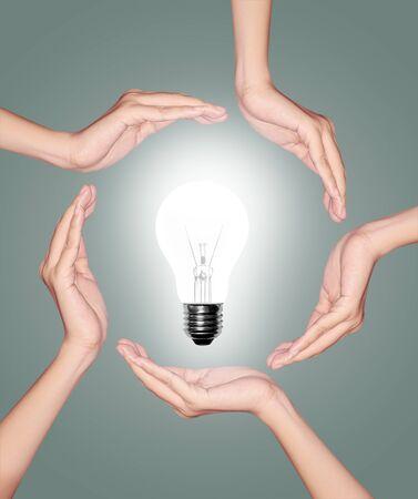 brilliant idea: Bulb light in woman hand on green background