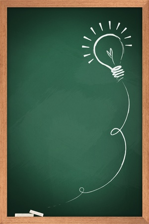 Drawing of a bulb idea on green board