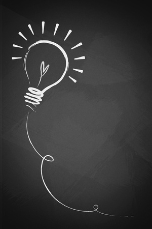 Drawing of a bulb idea on blackboard  photo