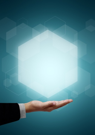 hexagon: Hand of business man have Hexagon above on green background.