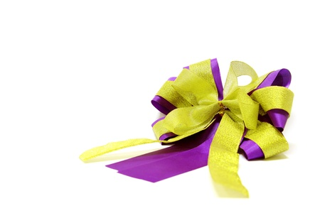 yellow and violet ribbon bow on white background. Stock Photo - 10017012