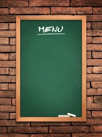 Menu green board on old wall Brick mortar background  photo