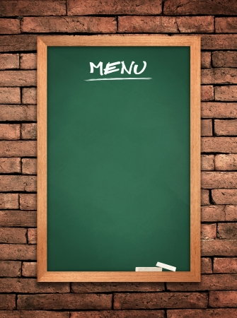 Menu green board on old wall Brick mortar background  photo
