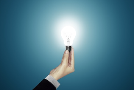 Light Bulb in woman hand Stock Photo - 10300606