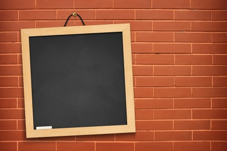Blackboard hanging on the walls orange. photo