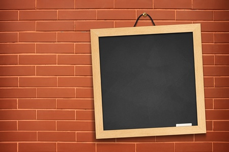 blackboard on orange wall background  photo