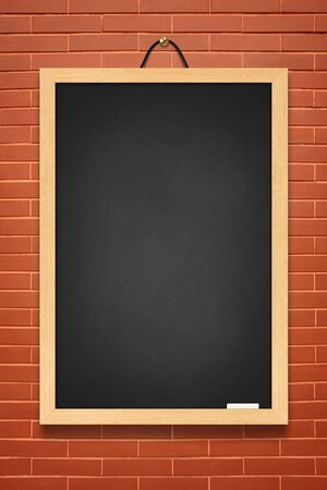 Blackboard hanging on a brick wall. photo