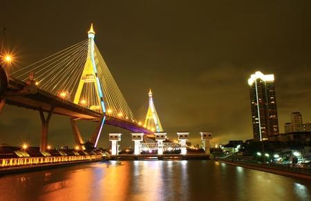 Bridge and dam at night of Bangkok, Thailand.