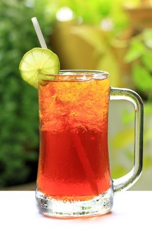 ice lemon tea: Iced Lemon Tea on green leaves background
