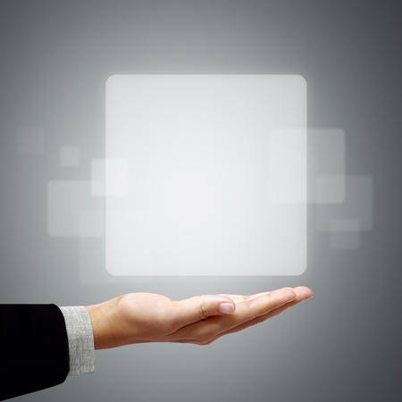 creative communication: Frame white square above the business hand on a gray background.
