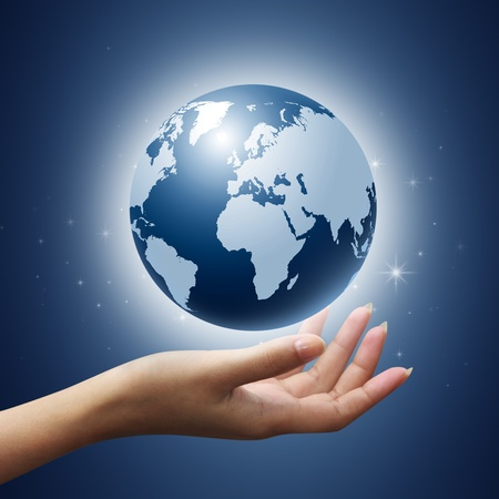 earth globe in woman hands on star and blue background photo