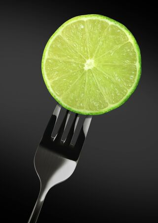 green lime on Stainless steel fork Stock Photo - 10989320