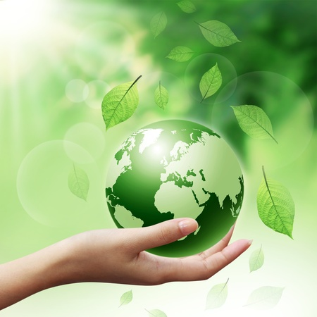planet earth: woman hands holding green earth with a leaf