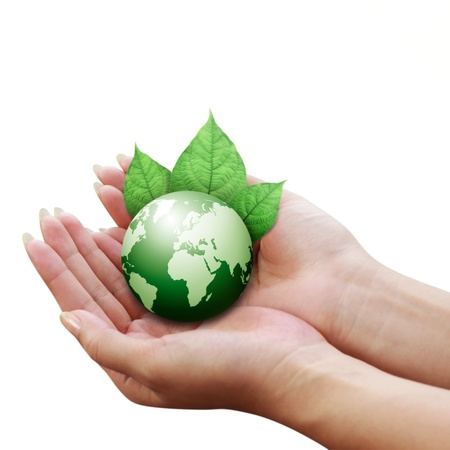 human hands holding green earth with a leaf isolated  photo